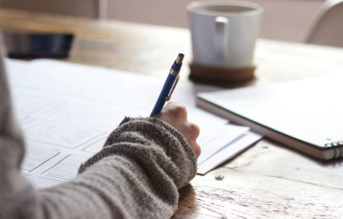 person planning paper and pencil