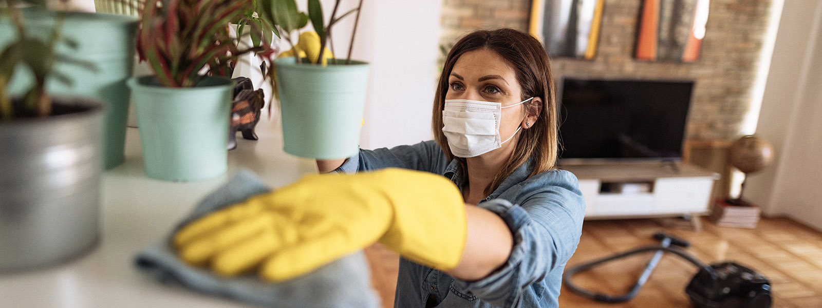 A woman cleans a shelf