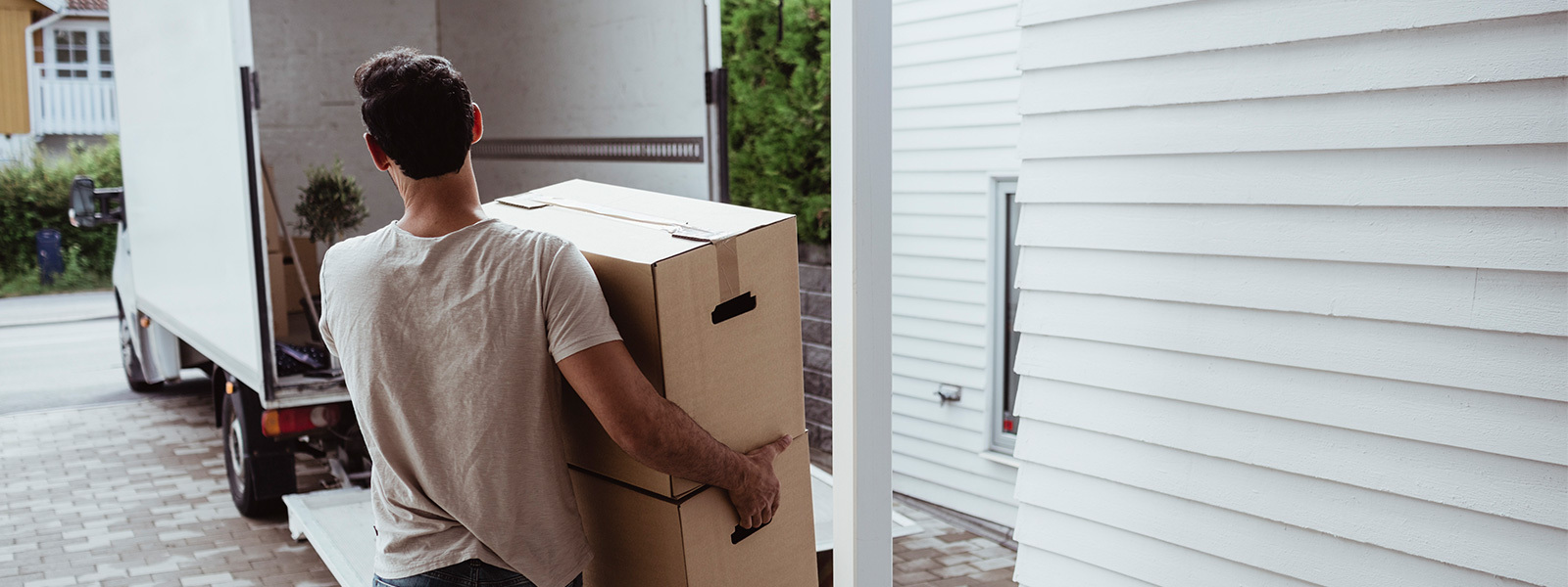 Man carrying boxes to a moving truck